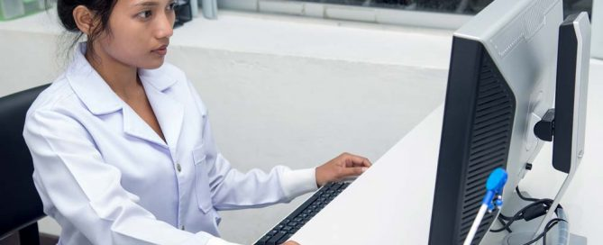 Medical practitioner working on a computer