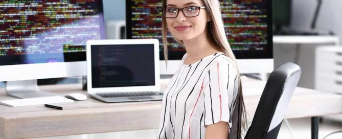 Picture of a woman smiling at her work desk