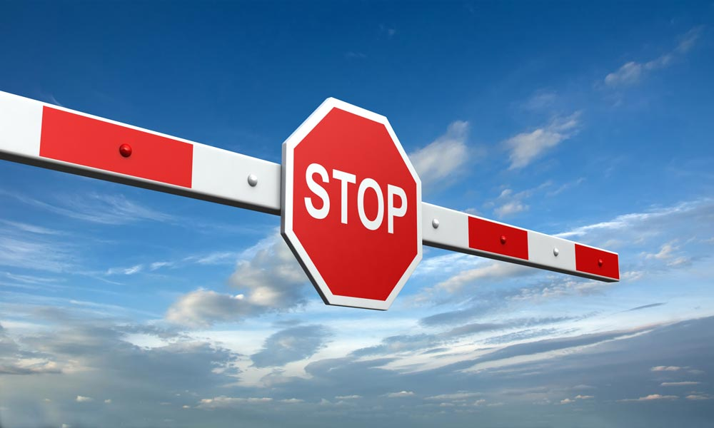 Gate and stop sign