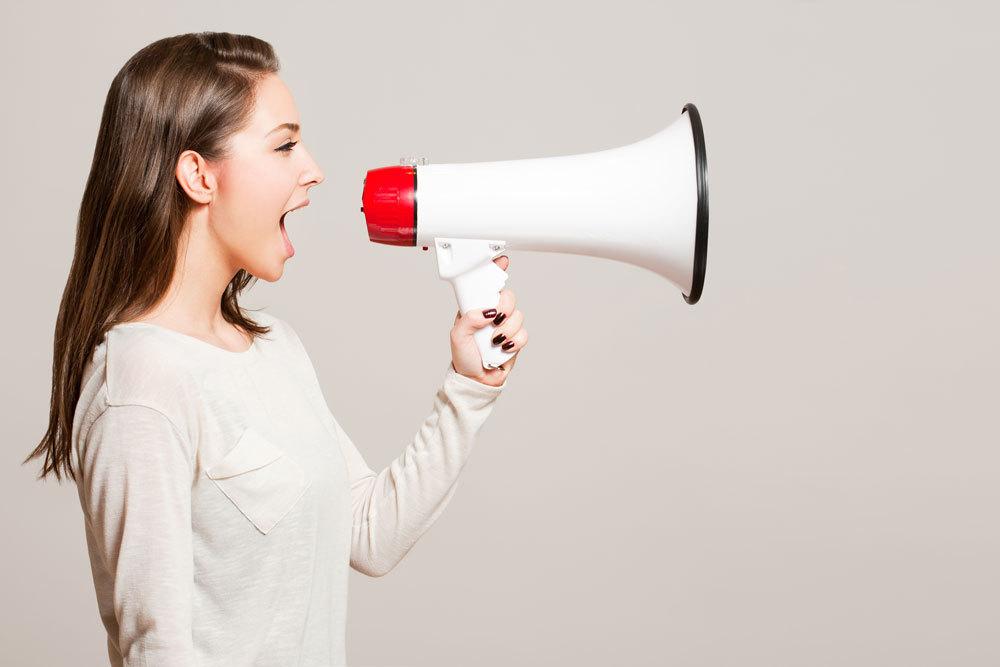 Women talking through a loud speaker