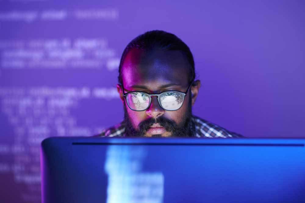 Software developer working on a laptop